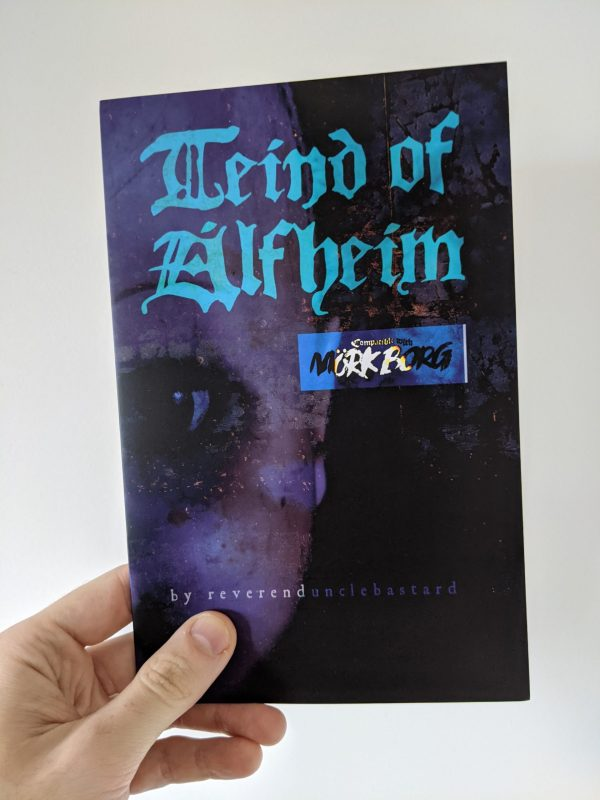 A blue and purple A5 zine held against a white wall. The cover hints at a face, but nothing is clear. The title reads Teind of Alfheim.