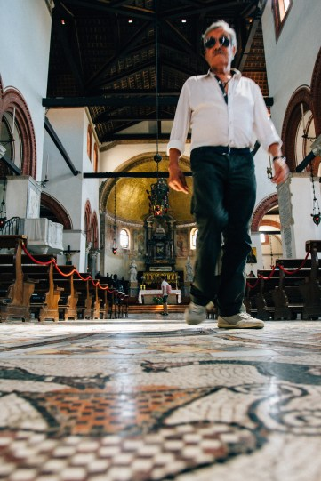 An old church in Murano, the floors were amazing old mosaics and this guy looks like he might have a few secrets.