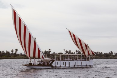 Another dahabiya with colorful sails.