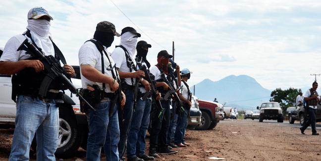 Autodefensas estarían trabajando para El Mencho - Se entregan 13 ex autodefensas de Michoacán
