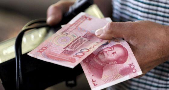 China devalúa el yuan por tercera vez - Foto de Reuters.
