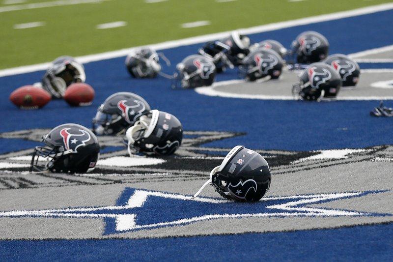Cancelan juego entre Texanos y Vaqueros tras paso de Harvey - Foto de AP/Tony Gutierrez