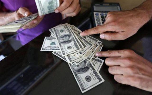 Dólar sigue superando barrera de los 21 pesos - Foto de Archivo