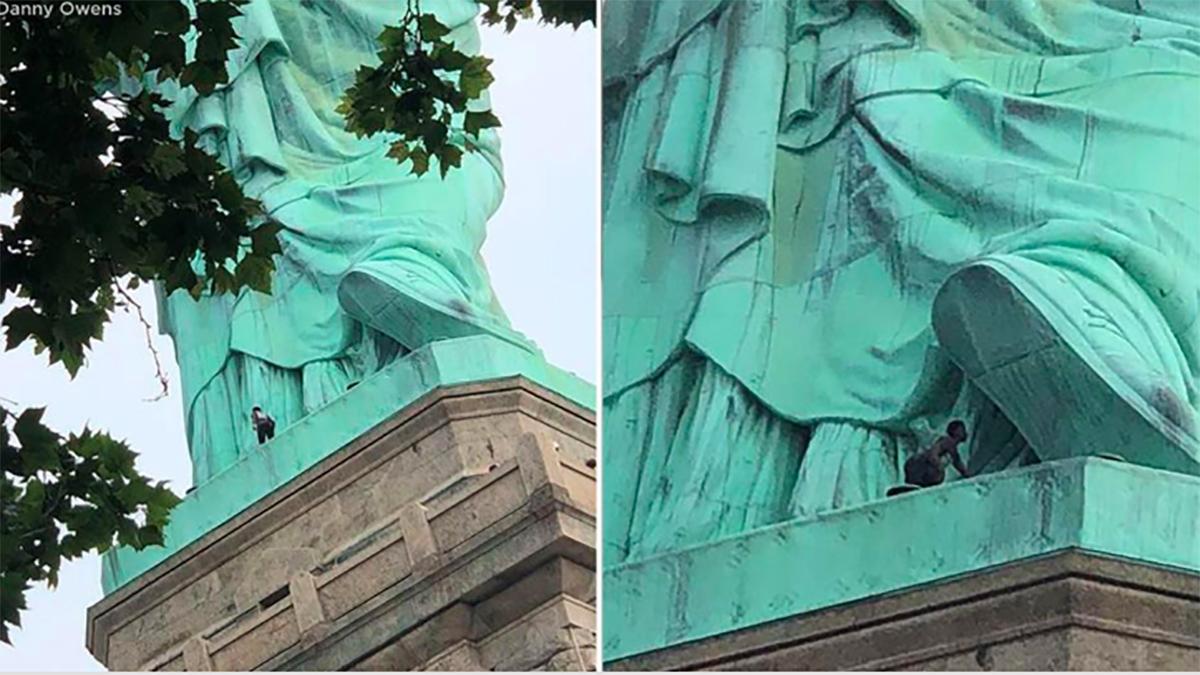Atrapan a mujer que subió la Estatua de la Libertad