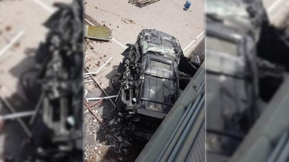 Desentierran camioneta de dueña del Rébsamen al retirar escombros - Foto de El Universal