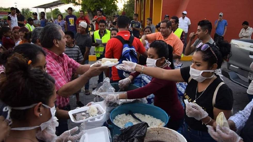 Desayuno a migrantes. Foto de El Sur Diario