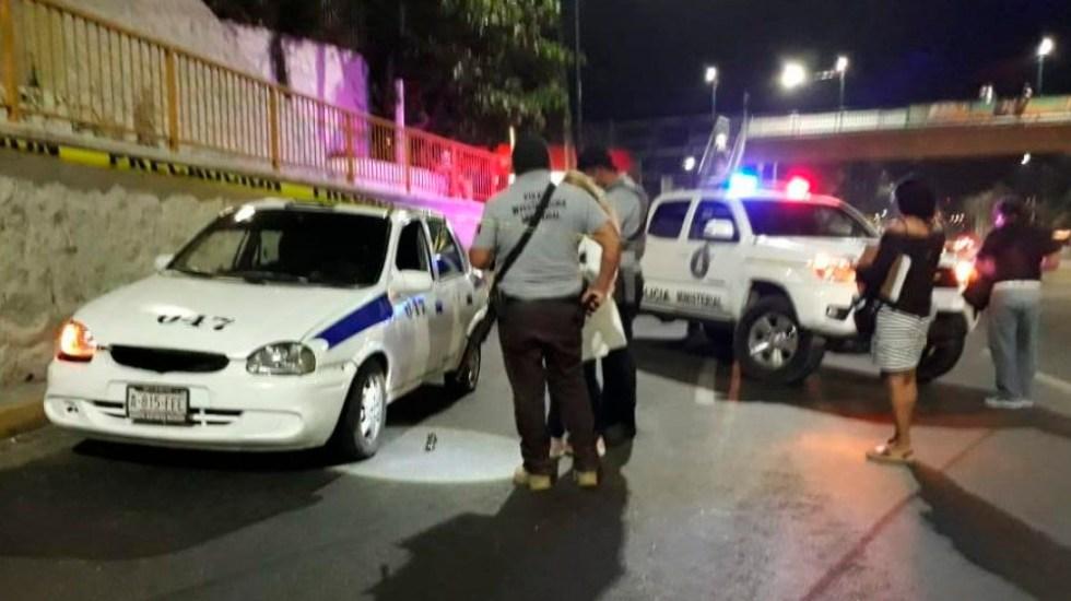 Hallan restos humanos dentro de taxi en Acapulco - Foto Especial