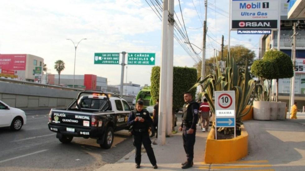 Policías vigilan gasolineras en Querétaro por desabasto de combustible - Foto de Quadratín