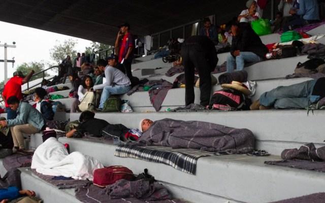 """Más de mil migrantes llegan al estadio Jesús Martínez """"Palillo"""" - Foto de Cuartoscuro"""