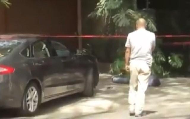 Detienen a escolta por abatir a asaltante en Polanco - Asaltante muerto por escolta. Captura de pantalla