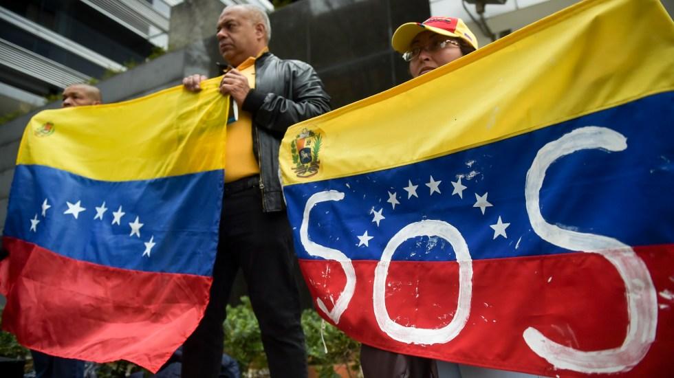 Estiman pérdidas de 875 mdd en Venezuela por apagón - SOS en Venezuela. Foto de AFP / Raúl Arboleda