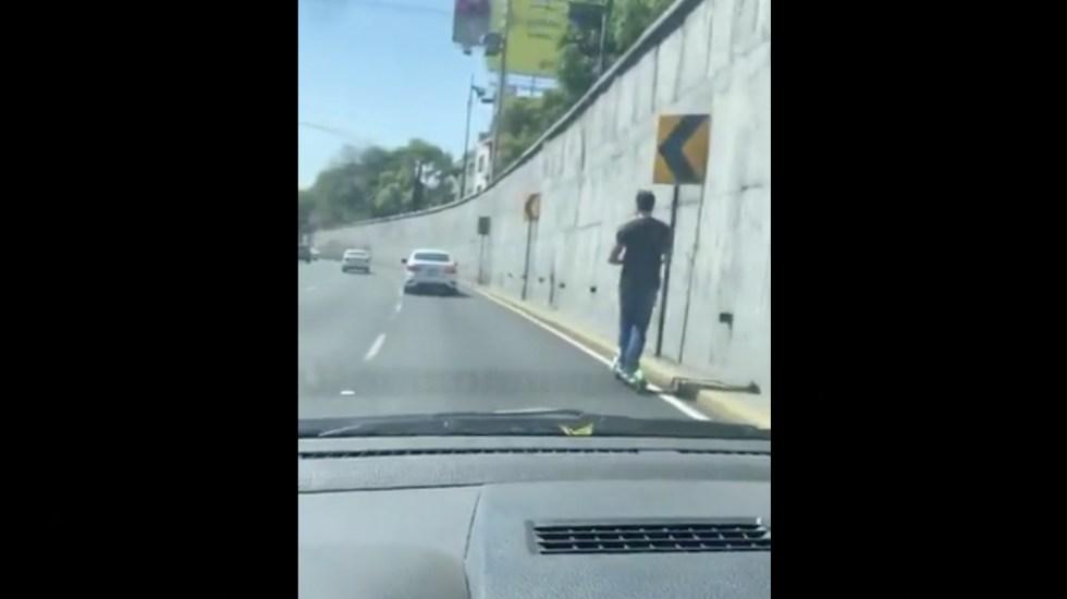 #Video Usuario de patín eléctrico en carriles centrales de Viaducto - Captura de pantalla