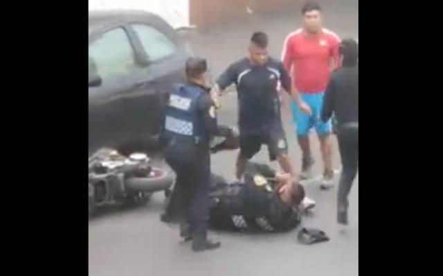 #Video Pelea con motociclistas deja dos policías heridos en la capital - Agresión a policías en la Venustiano Carranza. Captura de pantalla