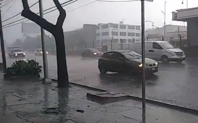 Activan Alerta Naranja por lluvia en cuatro alcaldías de la capital - Fuerte lluvia en Calz. de Tlalpan. Foto de OVIAL
