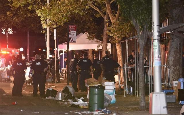 Tiroteo en Nueva York deja un muerto y once heridos - Oficiales de Nueva York en sitio del tiroteo. Foto de Todd Maisel
