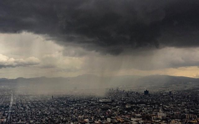 Prevén lluvias fuertes con granizo en el Valle de México - Lluvia cielo nublado chubascos