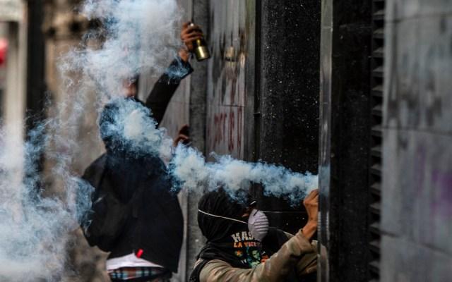 Habrá vigilancia sin represión: López Obrador sobre 2 de octubre - Actos vandálicos en un edificio sobre Avenida Juárez tras marcha de Ayotzinapa. Foto de Notimex