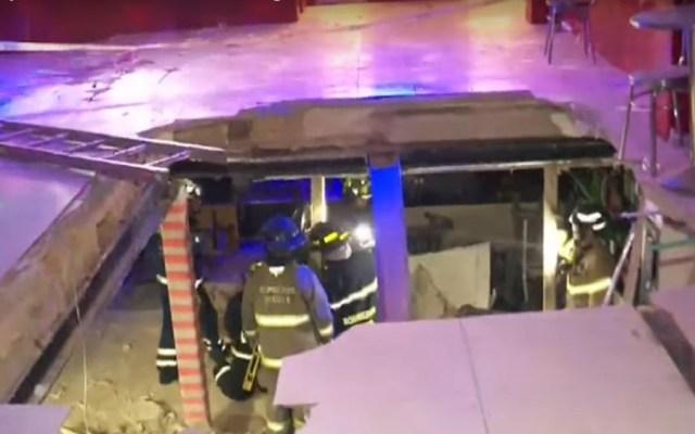 #Video Piso de discoteca se desploma en Bogotá - Desplome de piso en discoteca. Captura de pantalla / Noticias Caracol