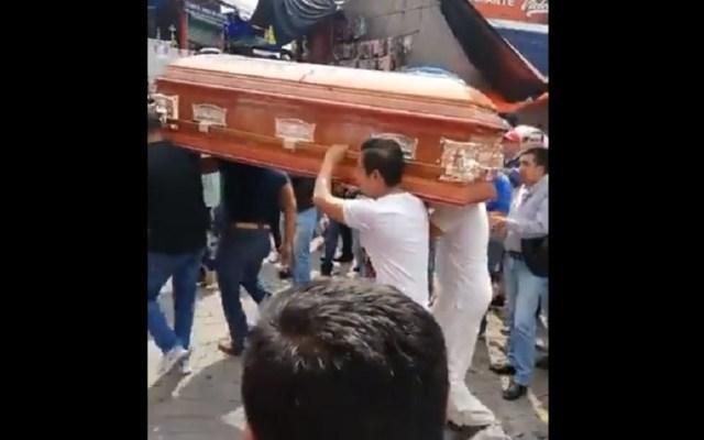 #Video Realizan funeral al ritmo de cumbia - Funeral al ritmo de cumbia en la CDMX. Captura de pantalla