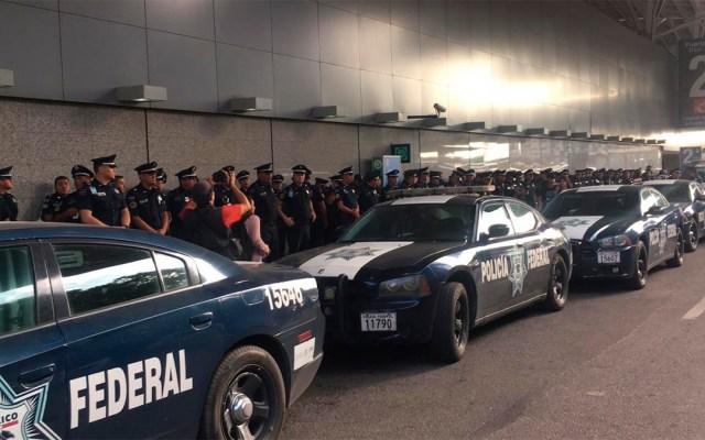 Despliegue policial en el AICM por posible manifestación - policía federal resguarda accesos al aicm por manifestantes