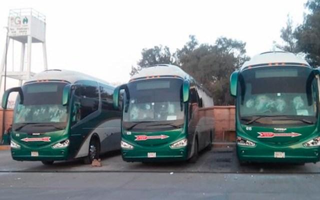 FGR investigará a normalistas de Tenería por secuestro de choferes - Autobuses vandalizados por normalistas de Tenería. Foto Especial / El Heraldo de México