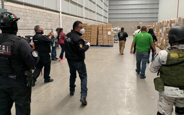 Recuperan en Edomex casi un millón de cubrebocas robados - Aseguramiento de bodega en Tultipark II. Foto de @FiscalEdomex