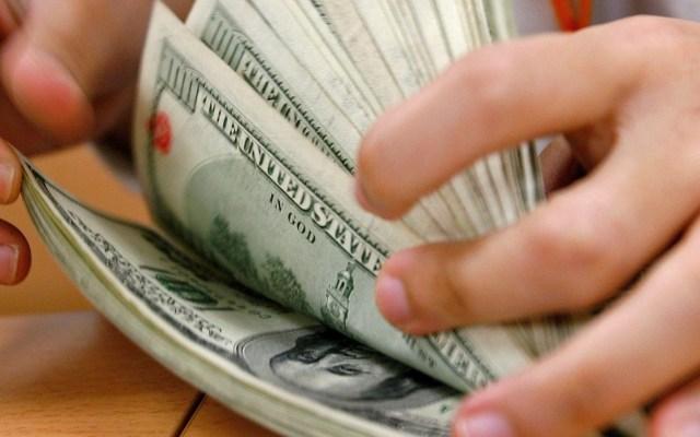 Detienen en EE.UU. a 27 integrantes de red de tráfico de drogas ligada al Cártel de Sinaloa - Dólares. Foto de EFE