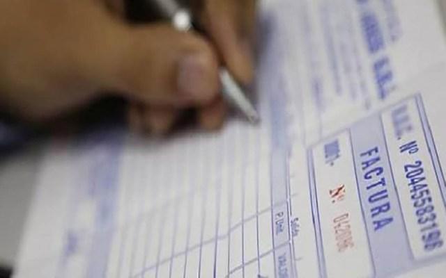 Procuraduría Fiscal irá por las cabezas de grupos factureros 'sean quien sean', afirma Carlos Romero - Factura. Foto Especial
