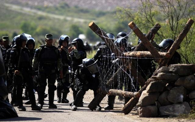 Gobierno federal abandona mesas de seguridad en Chihuahua; acusa Corral que fue por críticas tema del agua - Destacamento de la Guardia Nacional resguarda la presa Francisco I. Madero de Chihuahua. Foto de EFE