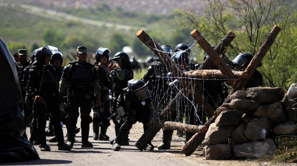 Corte admite controversia constitucional sobre dejar coordinación de mesa de seguridad en Chihuahua - Destacamento de la Guardia Nacional resguarda la presa Francisco I. Madero de Chihuahua. Foto de EFE
