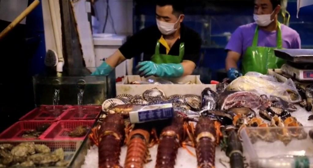 El mercado pekinés de Xinfadi suspende la venta de congelados como prevención. Noticias en tiempo real
