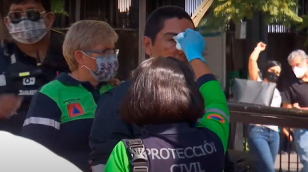 Riña entre peregrinos y personal de Protección Civil en la Basílica de Guadalupe - Golpean peregrinos a personal de Protección Civil en la Basílica de Guadalupe. Foto Captura de pantalla