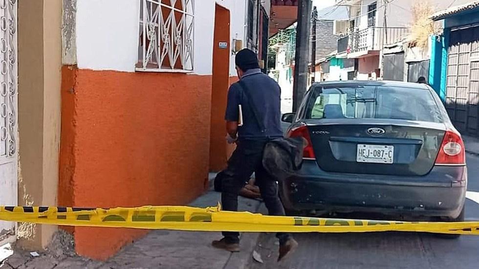 Suman 83 mil 765 homicidios dolosos en lo que va del sexenio - Escena del crimen en lavado de autos en Iguala. Foto de EFE / Archivo