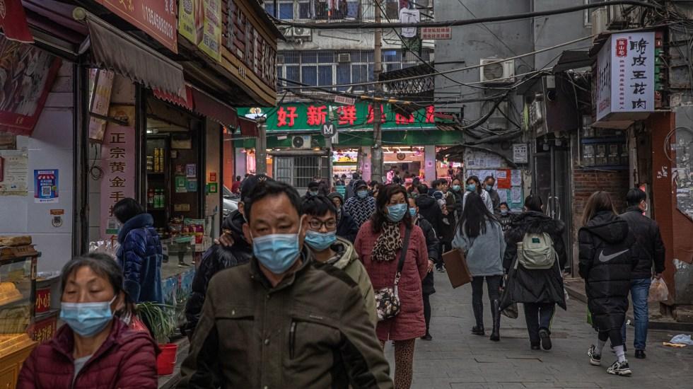 Afirma OMS que todas las hipótesis sobre el origen del COVID-19 siguen abiertas - Vida diaria en Wuhan a un año del confinamiento estricto por el COVID-19. Foto de EFE