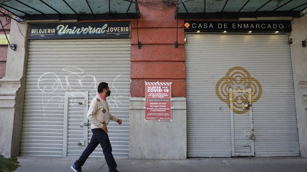 Pandemia de COVID-19 obligó al cierre de un millón de negocios en México durante 2020 - Negocios cerrados en México por pandemia de COVID-19. Foto de EFE