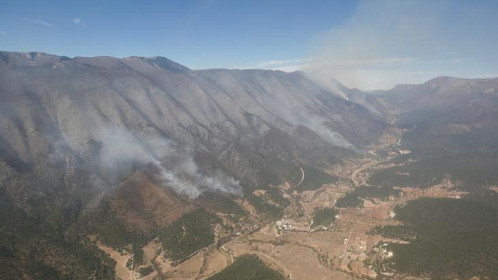 Regresarán pobladores a comunidades afectadas por incendio en Sierra de Santiago - Foto de Gobierno de Nuevo León