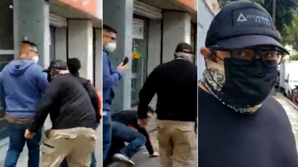Subdirector de fotografía de Notimex agrede a reportero en huelga - Notimex subdirector de foto empuja agresión