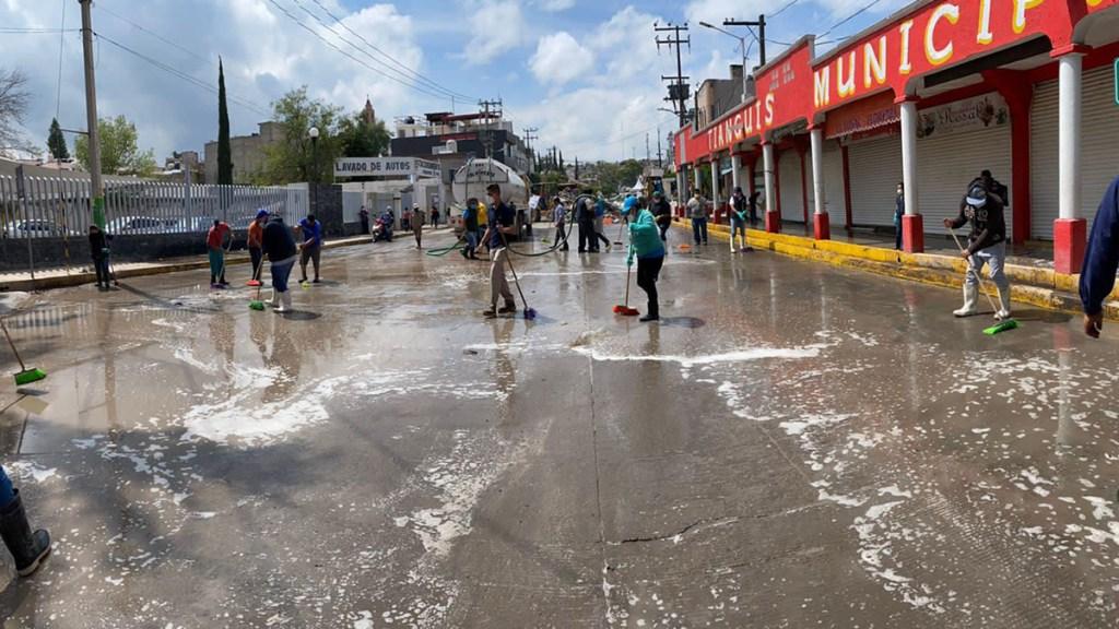 Emiten declaratoria de emergencia para nueve municipios de Hidalgo - Labores de limpieza de calles tras inundaciones en Tula