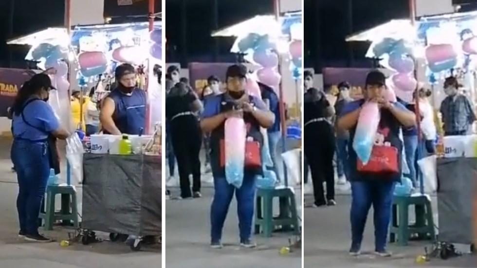 Comerciante sopla a bolsas con algodón de azúcar en Feria de Torreón - Puesto algodones de azucar Torreón