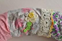 button flower on vintage fabric wreath