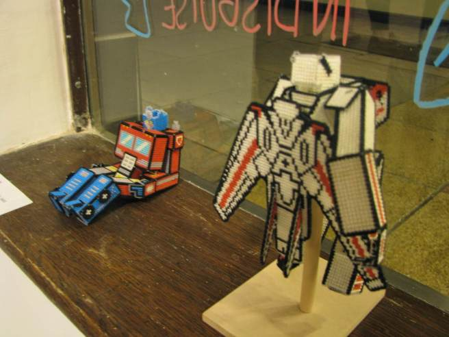 cross stitch transformers in window