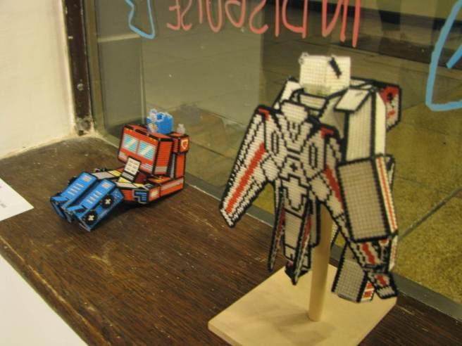 cross stitch transformers in window
