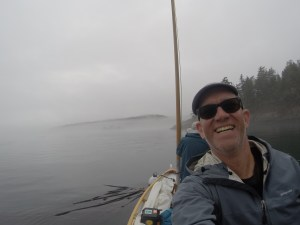 grinning Lord Sluggage in a selfie with foggy island scene in the background