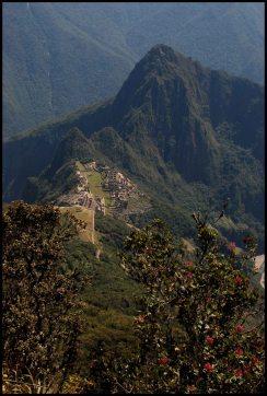 half way up the mountain Machu Picchu looking down at Machu Picchu main site, Uña Picchu and Huayna Picchu