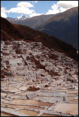 Salineras de Maras surrounded by mountains - Peru