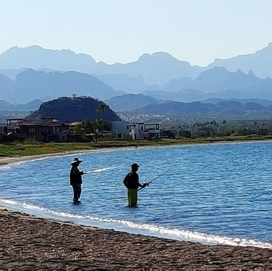 Do a little fishing on the Loreto Bay beach as the Sierra de la Giganta mountains loom in the background.