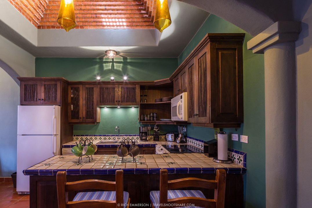 You can sit at the kitchen bar to eat. Above the kitchen is a brick cupola.
