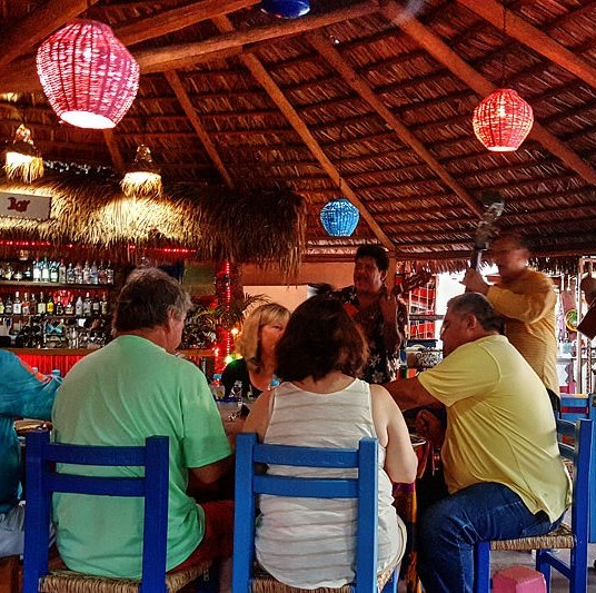 Mariachis entertain diners at La Palapa.