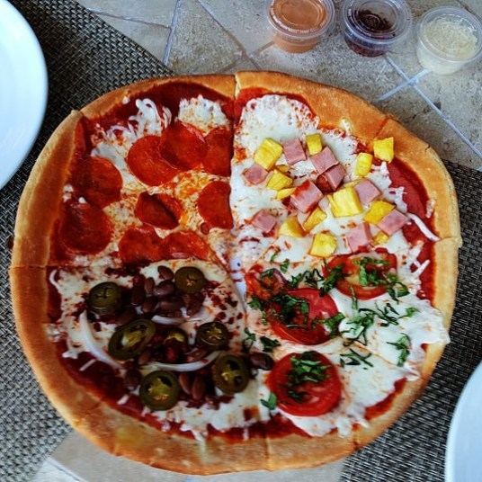 All you can eat made to order pizza at the Mezquite Grill inside La Mision hotel on Thursday nights.