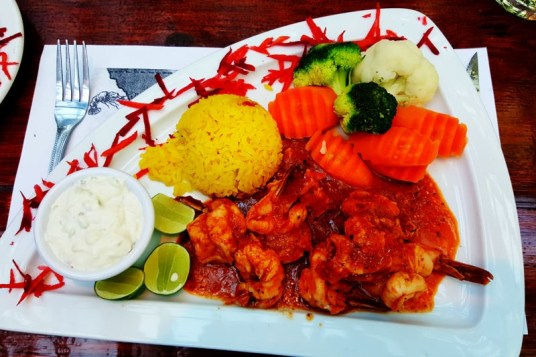 Camarones diavolo with vegetables and rice at Domingos Place.